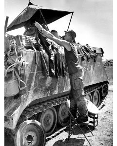 Soldier hangs out the laundry in South Vietnam, 1968