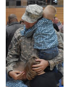 Returning soldier embraces his children