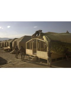 Building living quarters in Afghanistan, 2002
