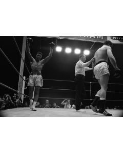Muhammed Ali raises his arms in victory over Karl Mildenberger, 1966