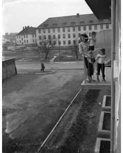 Family on balcony of their new apartment, Aschaffenburg, 1950