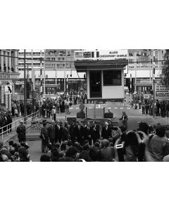 Dignitaries stand in front of Checkpoint Charlie in Berlin