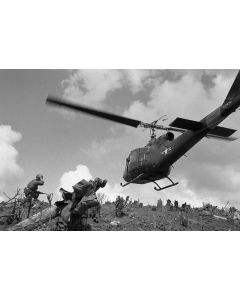 A Marine helicopter lands to bring supplies and evacuate the wounded, 1966