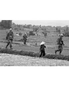 Cavalrymen on patrol walk past a farmer tending his fields, 1968