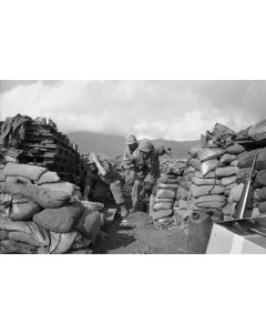 Marines scramble for safety in a bunker at Khe Sanh base in Vietnam, 1968