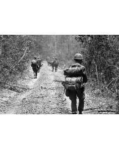 Men of the 1st Aviation Battalion, 18th Infantry move down the road, 1968