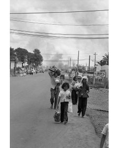 Refugees flee burning buildings, 1968