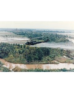 A U.S. Huey helicopter sprays Agent Orange over Vietnam